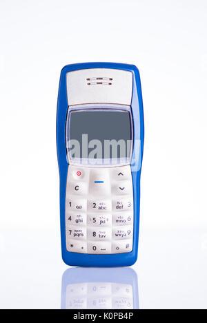 Retro mobile phone isolated on white background - Stock Photo
