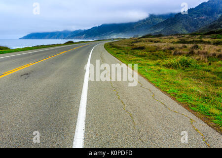 Rocky California coast road twists and turns around rugged points of land - Stock Photo