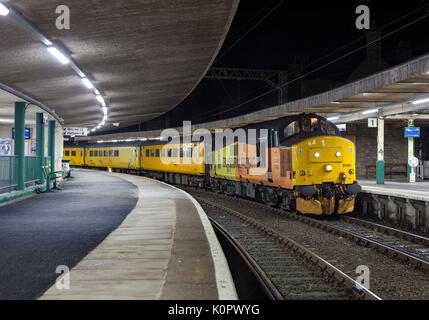 Colas Railfreight class 37 locomotive at Carnforth with a Carlisle  - Blackpool North Network Rail infrastructure - Stock Photo