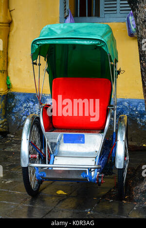 Cycle rickshaw (cyclo) in Hoi An Town, Vietnam. Cycle rickshaws are widely used in major cities of South, Southeast - Stock Photo