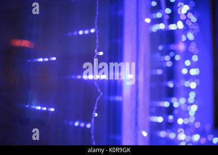 abstract blurred of blue and silver glittering shine bulbs lights background:blur of Christmas wallpaper decorations - Stock Photo
