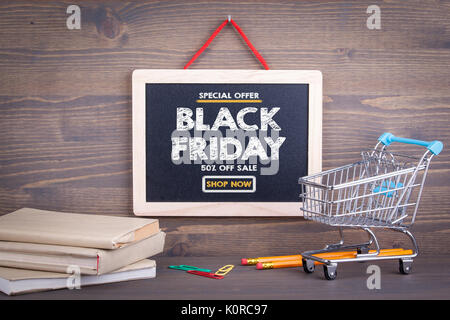 Black Friday sale. Chalkboard on a wooden background. - Stock Photo