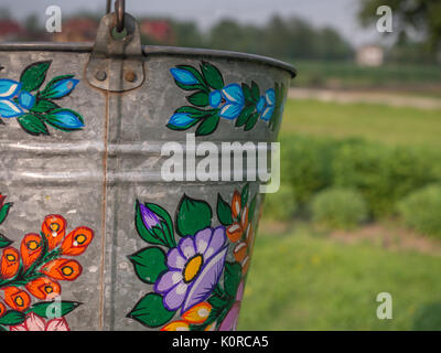 Zalipie, Poland - May 20, 2017: A bucket over a well in the colorful village - Zalipie, heritage park where all - Stock Photo