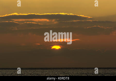 Winter sunset over Cardigan Bay in Aberystwyth - Stock Photo