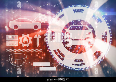 Graphic image of tools and car against computer screen with wallpaper - Stock Photo