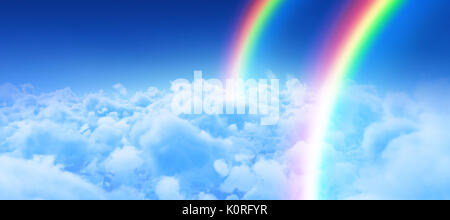 Digital image of rainbow against view of overcast against blue sky - Stock Photo