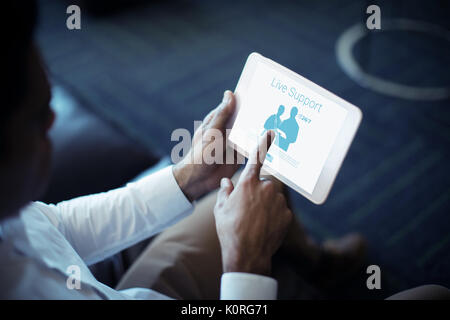 Live support text with human representations against cropped image of businessman using tablet - Stock Photo