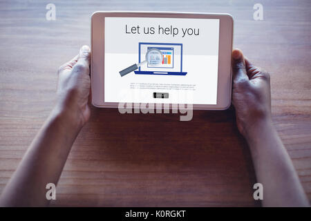 Let us help you text with computer icon against cropped hands of woman using digital tablet - Stock Photo