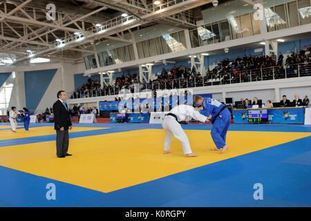 St. Petersburg, Russia - April 16, 2016: Match Khaiyomiddin Zhabborov of Tajikistan (white) vs Roy Schipper of Netherlands - Stock Photo