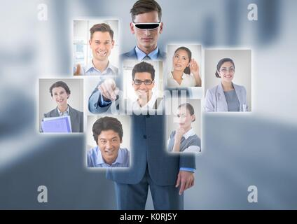 Digital composite of Businessman wearing Virtual reality headset interacting and choosing a person from group of - Stock Photo