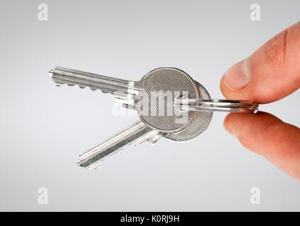 Digital composite of Hand holding keys - Stock Photo