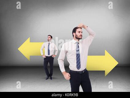 Digital composite of Left or right arrows with Businessman looking in opposite directions - Stock Photo