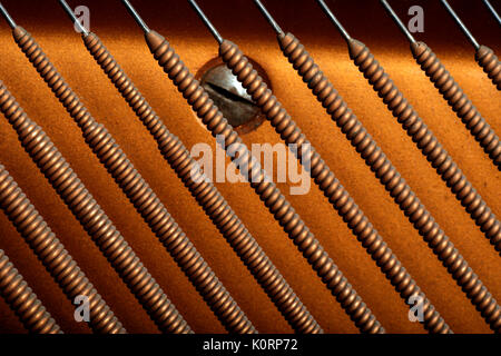 Bass strings from an upright piano - Close-up detail - Stock Photo