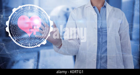 Midsection of female doctor using digital screen against doctor scanning patient on machine - Stock Photo