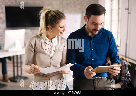 Picture of perspective designers using tablet in office - Stock Photo