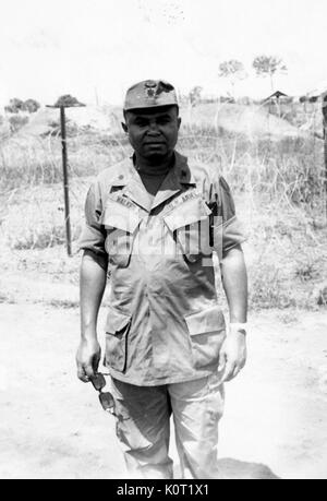 African-American United States Army Lieutenant AL Walker standing in front of barbed wire at Phuoc Vinh Base Camp, - Stock Photo