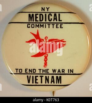 An anti-Vietnam War protest pin created by the New York Medical Committee, it reads 'NY Medical Committee to end - Stock Photo