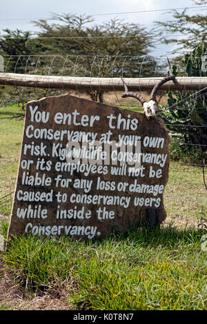 Warning sign outside of the Kigio Wildlife Conservancy in Kenya, Africa. - Stock Photo