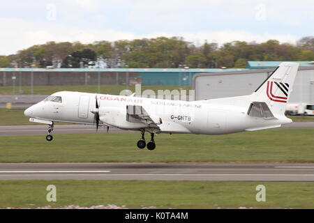 G-GNTB, a Saab 340 operated by Loganair, during training at Glasgow Prestwick International Airport in Ayrshire. - Stock Photo