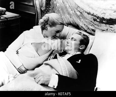BETTE DAVIS, GENE RAYMOND, EX-LADY, 1933 - Stock Photo