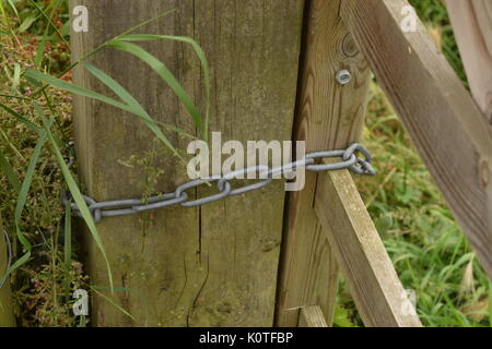 Close up of wooden gate hinge - Stock Photo