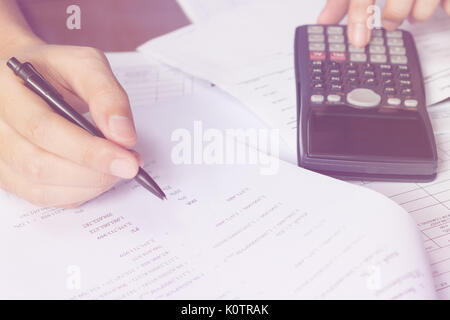 savings, finances, economy and home concept - close up of man with calculator counting making notes at home, hand - Stock Photo