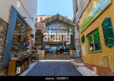 Entrance to the Provencal market in Antibes, France - Stock Photo