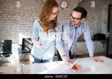 Portrait of two architects looking at project scheme - Stock Photo