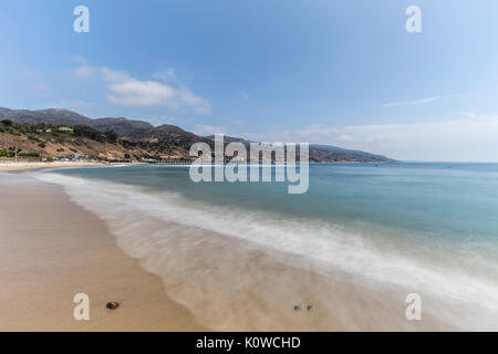 Malibu beach with motion blur surf near Los Angeles in Southern California. - Stock Photo