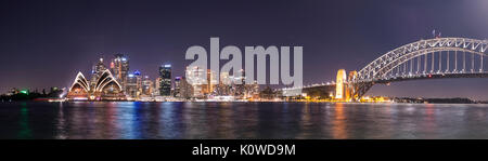 Circular Quay and The Rocks at night, skyline with Sydney Opera House, Harbor Bridge, Financial District, Banking - Stock Photo