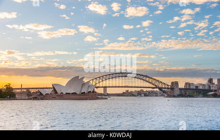 Circular Quay and The Rocks at dusk, skyline with Sydney Opera House, Harbor Bridge, Opera, Financial District, - Stock Photo