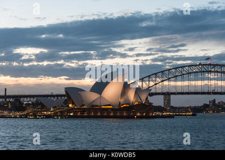 Circular Quay and The Rocks at dusk, skyline with Sydney Opera House, Opera, in the back Financial District, Banking - Stock Photo