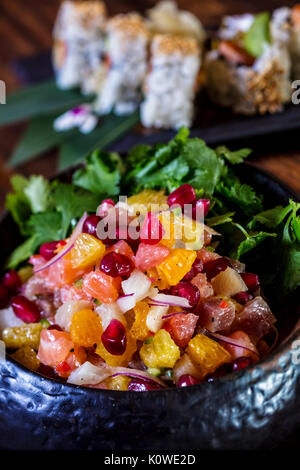 Luxury fruit salad with sushi in background - Stock Photo