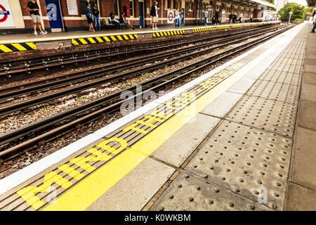 Mind the gap, mind the gap sign, mind the gap London train station sign, mind the gap warning, mind the gap London - Stock Photo