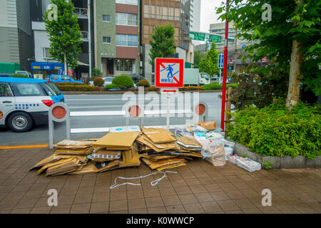 TOKYO, JAPAN JUNE 28 - 2017: Recycling area with paperboards, books, notebooks and newspaper in the sidewalk in - Stock Photo