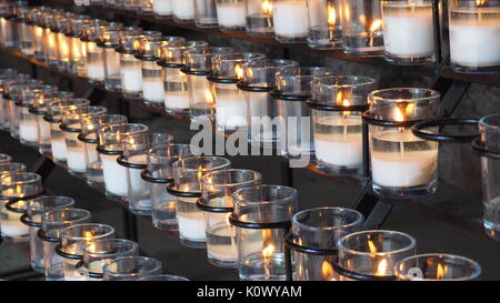 candle pray at grotto - Stock Photo