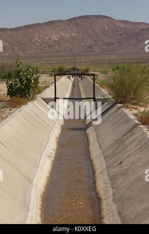 An irrigation ditch in the Nevada desert - Stock Photo