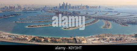 Dubai The Palm Jumeirah Island panorama Marina aerial panoramic view photography UAE - Stock Photo