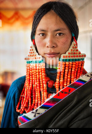 A Tibetan bride before her wedding. Tibetan plateau - Stock Photo