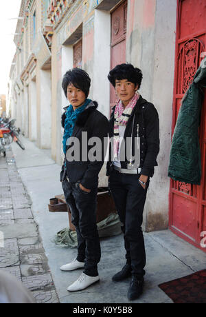 Modern day Tibetan fashionistas, those who have left traditional life and have been absorbed by Chinese fashion. - Stock Photo