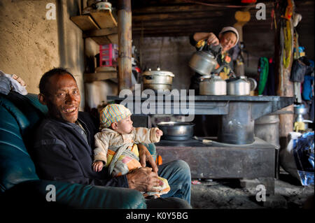 Tibetan family in action. Tibetan plateau - Stock Photo