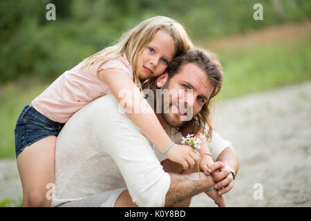 Father and daughter together in the forest