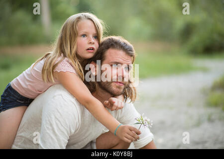 Father and daughter together in the forest - Stock Photo