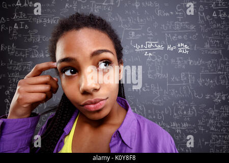 schoolgirl genius in education- Back to school - Stock Photo