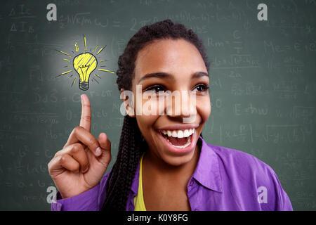 happy schoolgirl genius in mathematics have a solution - Stock Photo