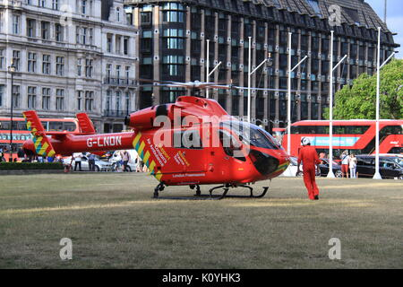 London Air Ambulance (HEMS) MD-902 Explorer at Parliament Square attending a medical emergency - Stock Photo