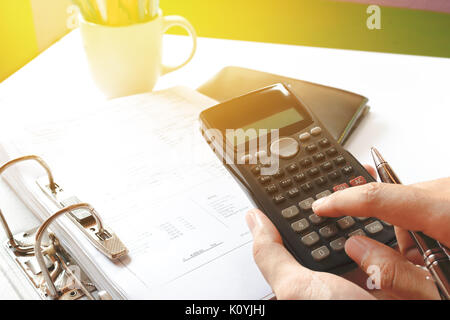 close up of man with calculator counting making notes in the crisis at home, soft focus. - Stock Photo