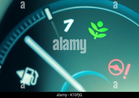 Eco drive light icon on car dashboard. Eco-driving concept - Stock Photo