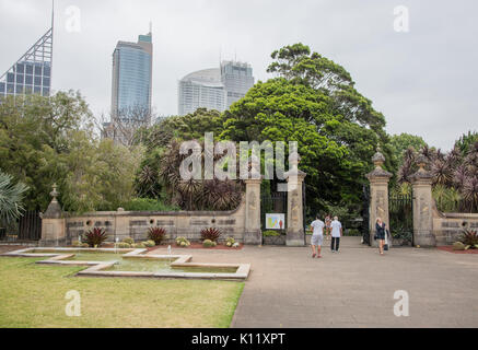 SYDNEY,NSW,AUSTRALIA-NOVEMBER 19, 2016: Tourists at entrance to the Royal Botanic Gardens with city buildings in - Stock Photo
