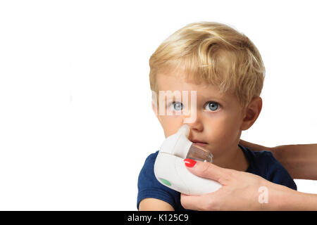 Mother using baby electric nasal aspirator. She is doing a mucus suction to twenty months baby boy,white backgrounds. - Stock Photo